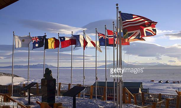 Flags of the original 12 signatory nations of the Antarctic Treaty fly next to a bust of Admiral Richard Byrd at McMurdo Station on October 21, 2005...