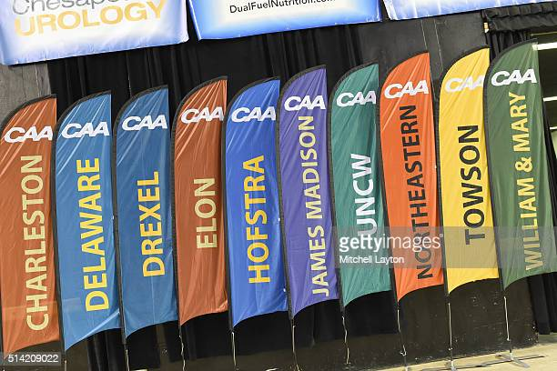 Flags of the schools line the wall during the Colonial Athletic Conference Championship college basketball game tournament between the North...
