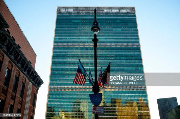 Flags of the United States are seen in front of the building of the United Nations before the start of a United Nations Security Council meeting on...