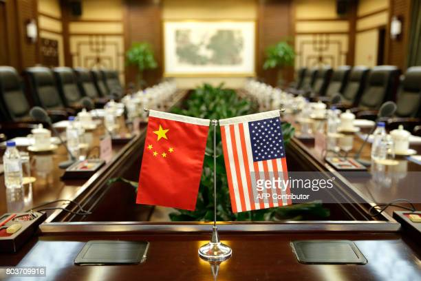 Flags of the US and China are placed ahead of a meeting between US Secretary of Agriculture Sonny Perdue and China's Agriculture Minister Han Changfu...