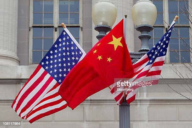 Flags of the US and China fly along Pennsylvania Avenue in Washington DC US on Monday Jan 17 2011 Hu Jintao president of China arrives in Washington...