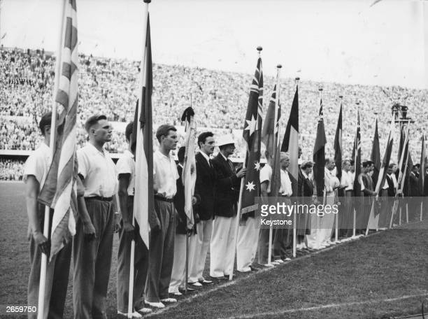 Flags of the various nations which took part in the 1952 Olympic Games in Helsinki Finland standing furled during the closing ceremony