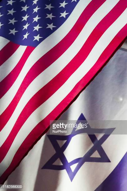 Flags of United States and Israel are seen waving at one of the hotels in Kazimierz historical Jewish district in Krakow Poland on November 9 2019