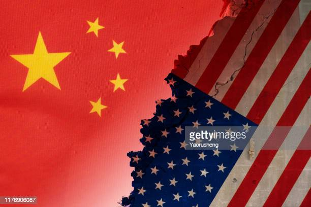 flags of usa and china painted on cracked wall - china stock pictures, royalty-free photos & images