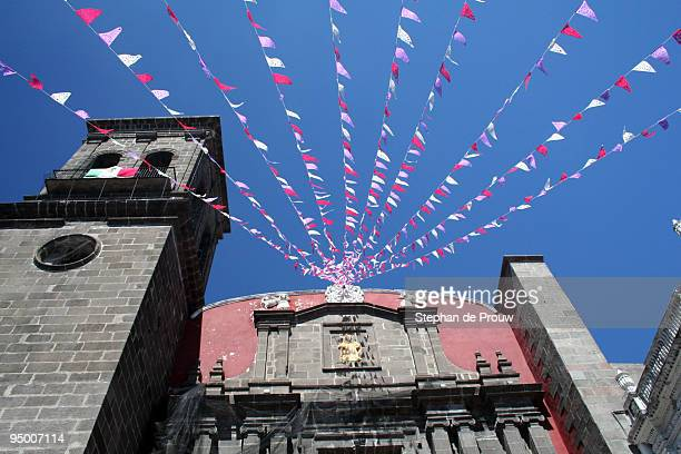 flags on a church - stephan de prouw stock pictures, royalty-free photos & images