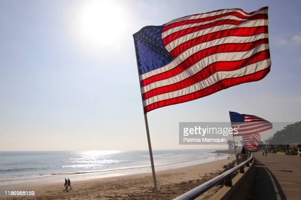 u.s. flags on the beach - american flag ocean stock pictures, royalty-free photos & images