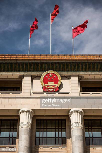 Flags on the top of the Great Hall of the People wave on March 9, 2016 in Beijing, China. The 12th National People's Congress goes on till March 16th.