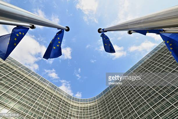 EU flags outside European Commission building in Brussels