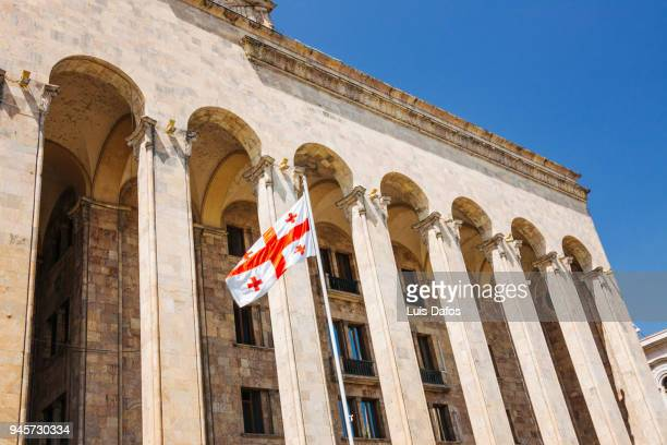 flags outside the former georgian parliament building. - dafos stock photos and pictures