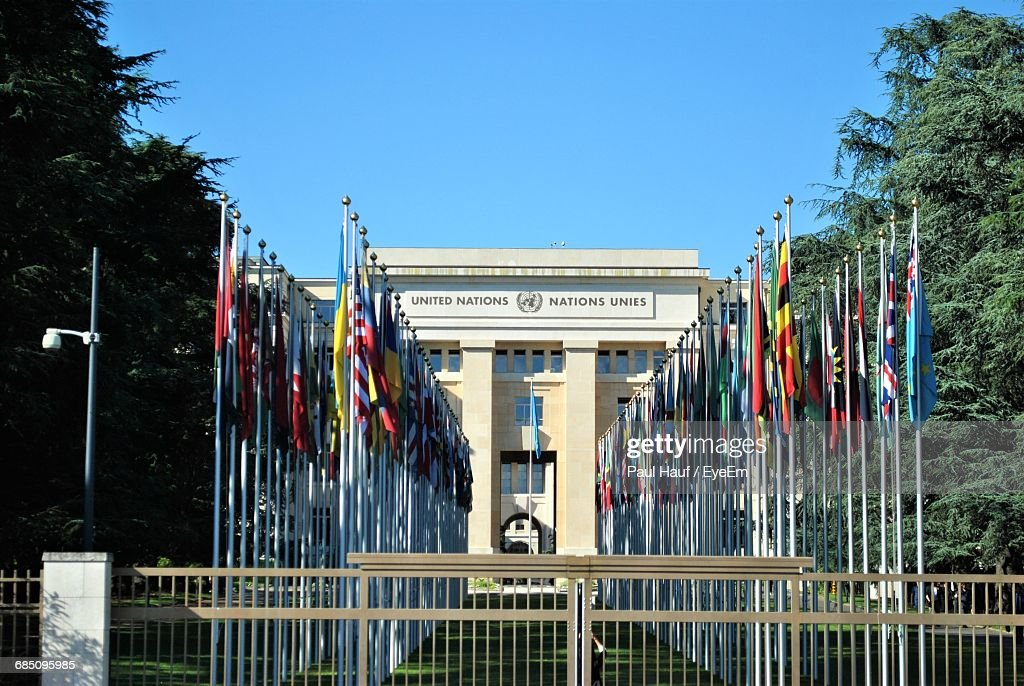 Flags Outside United Nations Office At Geneva Against Clear Sky : ストックフォト