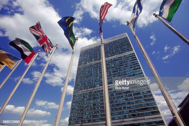 flags outside united nations - united nations building stock pictures, royalty-free photos & images
