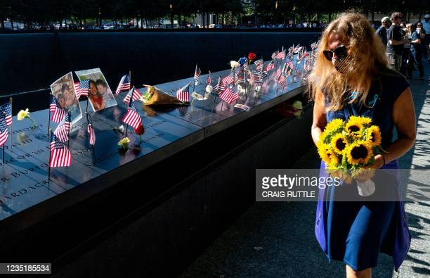 Flags, photos and flowers adorn the National 9/11 Memorial during the ceremony commemorating the 20th anniversary of the 9/11 attacks on the World...