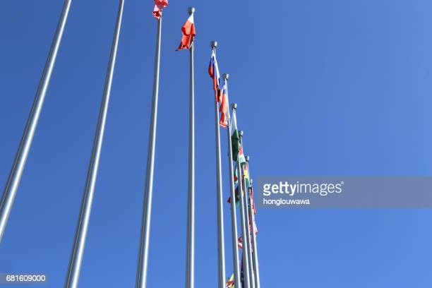 flags - flagpole sitting stock photos and pictures