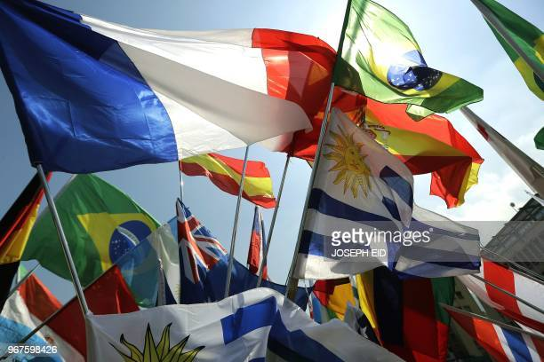 Flags representing countries that will be competing in the upcoming FIFA football World Cup in Russia are sold on the Sarba highway north of Beirut...