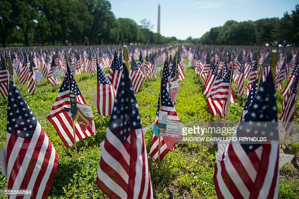 Flags representing fallen soldiers are planted on the National Mall during the annual Rolling Thunder 'Ride for Freedom' parade ahead of Memorial Day...