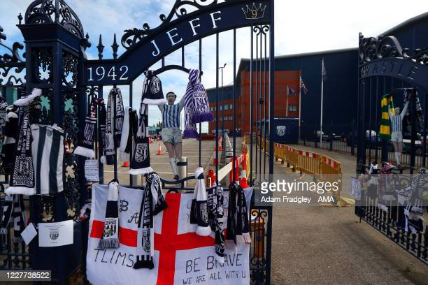 Flags shirts scarves and messages of good luck tied onto the gates of The Hawthorns the home stadium of West Bromwich Albion ahead of the Sky Bet...