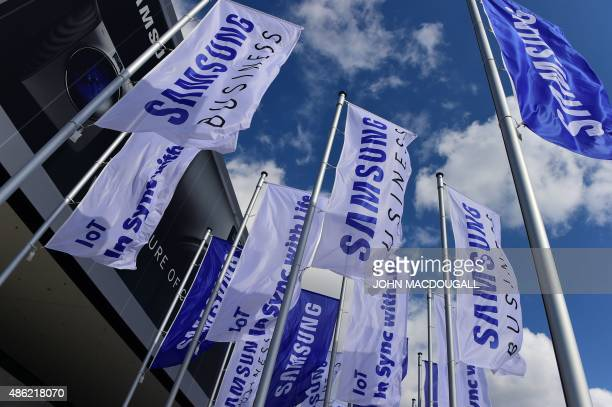 Flags sporting the logo of South Korean electronics giant Samsung flutter ahead of the opening of the 55th IFA on September 2 2015 in Berlin IFA one...