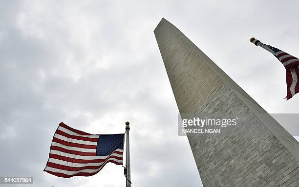 US flags surronding the base of the Washington Monument flutter in a breeze on the Mall July 1 a popular spot to watch the Independence Day holiday...