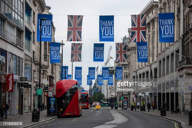 Flags thanking the public and key workers hang above Oxford Street as stores prepare to reopen in London, U.K., on Thursday, June 11, 2020. The...