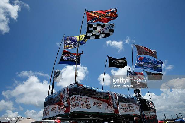 Flags wave above a tailgating spot over the infield during the NASCAR Sprint Cup Series Coke Zero 400 at Daytona International Speedway on July 6...