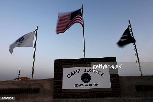 Flags wave above the sign posted at the entrance to Camp Justice, the site of the U.S. War crimes tribunal compound on May 31, 2009 at U.S. Naval...