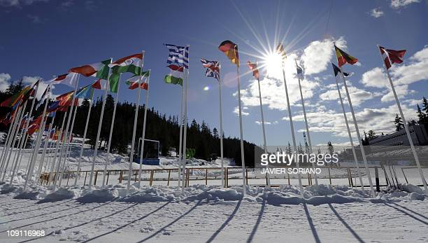 Flags wave at Olympic Park stadium in Whistler on February 9 2010 before the start of the 2010 Winter Olympics with the opening ceremony in Vancouver...