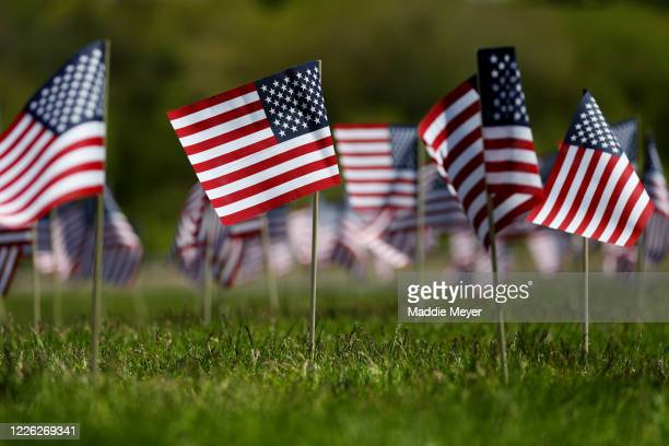 Flags wave in the wind outside of Gillette Stadium on May 21 2020 in Foxborough Massachusetts The Patriots foundation partnered with the...
