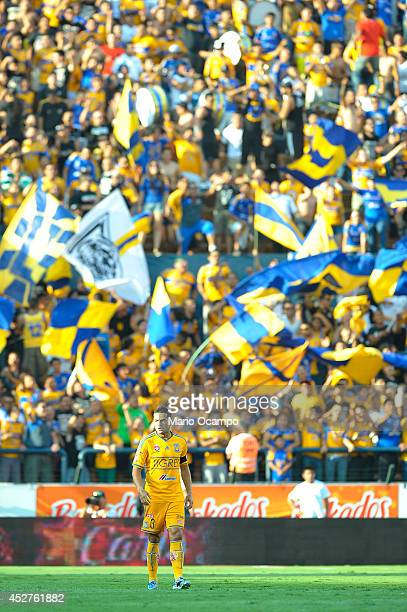 Flags wave on the background as Anselmo Vendrechovski Juninho of Tigres walks on the field during a match between Tigres UANL and Leon as part of 2nd...