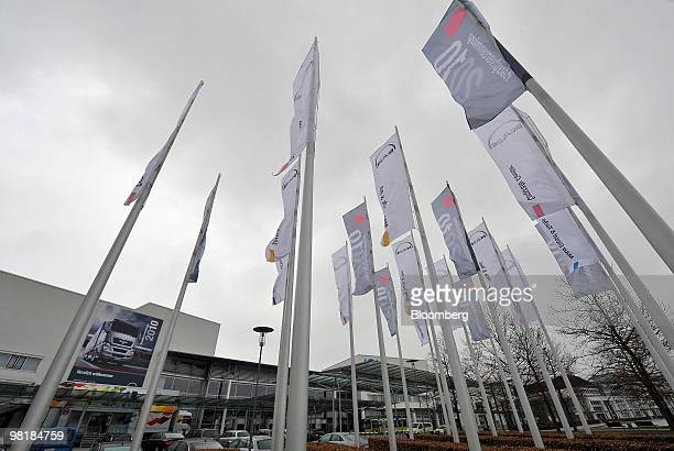 Flags wave outside the company's annual shareholders' meeting in Munich, Germany, on Thursday, April 1, 2010. MAN SE, Europe's third-biggest...