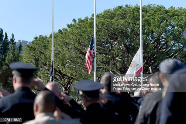 Flags were at half mast as the memorial service begins for Gardena Police Officer Toshio Hirai at Green Hills Memorial Park in Rancho Palos Verdes on...