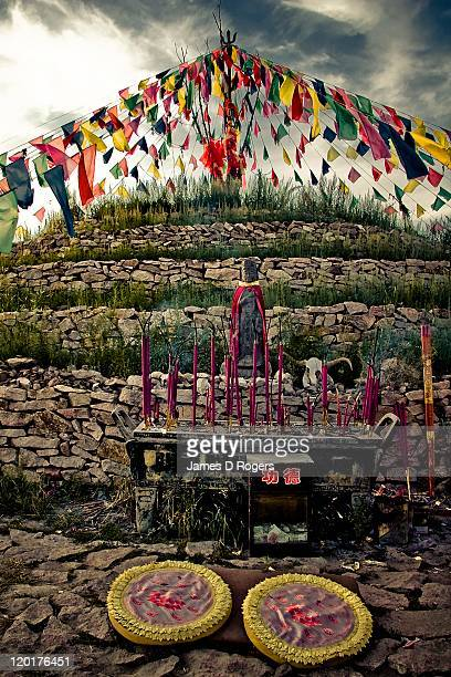 flags with incense burns, bashang grasslands - faith rogers stock pictures, royalty-free photos & images