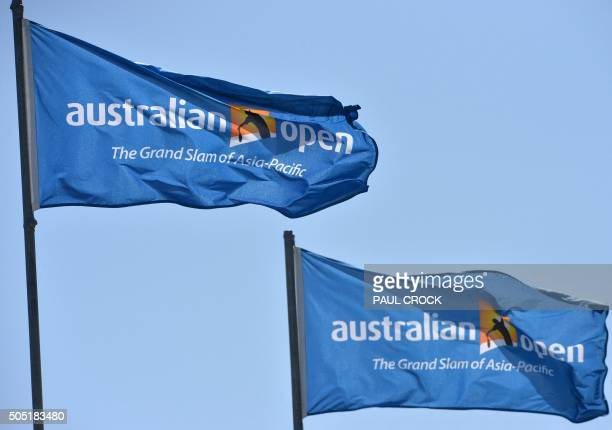 Flags with logos on display flutter in the wind ahead of the 2016 Australian Open tennis tournament in Melbourne on January 16 2016 AFP PHOTO / PAUL...