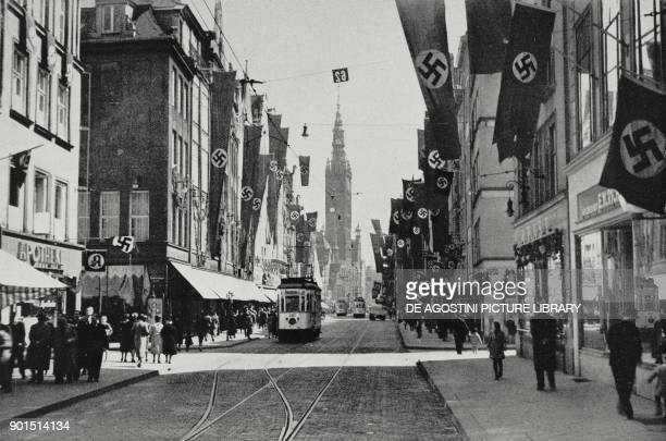 Flags with swastikas in the streets of Gdansk at the German national day Poland from L'Illustrazione Italiana Year LXVI No 34 August 20 1939