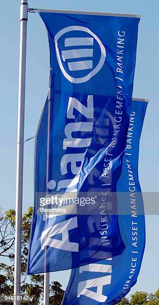 Flags with the Allianz logo fly in front of the company's shareholders meeting in Munich Germany Wednesday May 2 2007 Allianz SE and Axa SA Europe's...