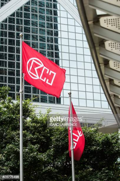 Flags with the CK Hutchinson Holdings logo are seen outside their headquarters at Cheung Kong Center in the Central district of Hong Kong on August 3...