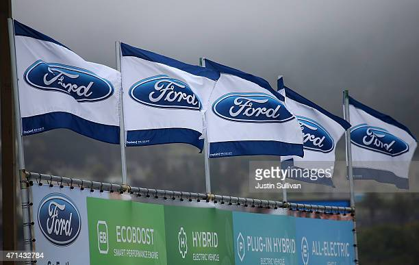 Flags with the Ford logo are posted in front of Serramonte Ford on April 28 2015 in Colma California Ford Motor Co reported a 66 percent drop in...