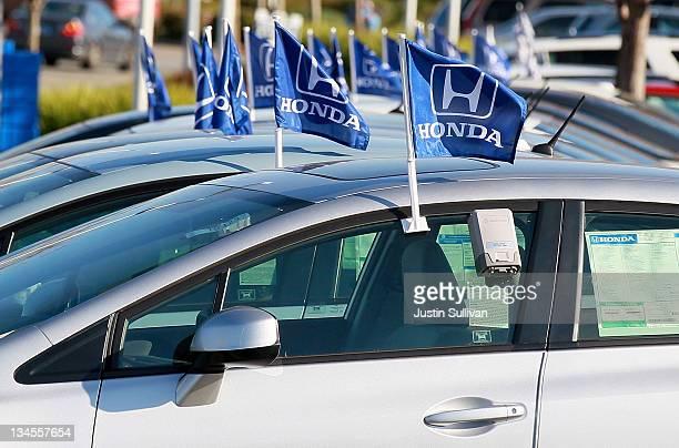 Flags with the Honda logo are displayed on brand new Honda cars at Marin Honda on December 2 2011 in San Rafael California Honda Motor Co announced...