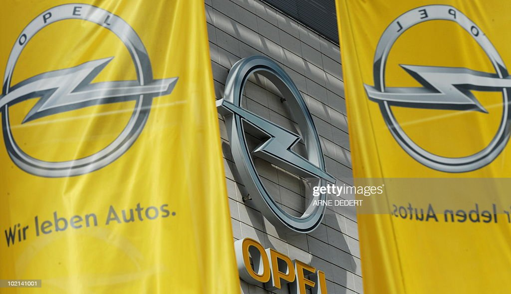 Flags with the logo of German carmaker Opel flutter in front of Opel's plant in Ruesselsheim, western Germany, on June 16, 2010. General Motors ditched a bid for European state aid for its loss-making Opel unit, saying the parent group had the financial firepower to pay for a restructuring itself.