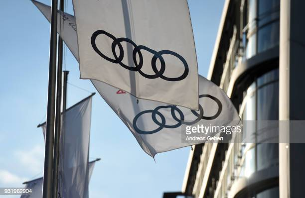 Flags with the logo of the German car manufacturer Audi blow in the wind in front of the Audi headquarters on March 14, 2018 in Ingolstadt, Germany....