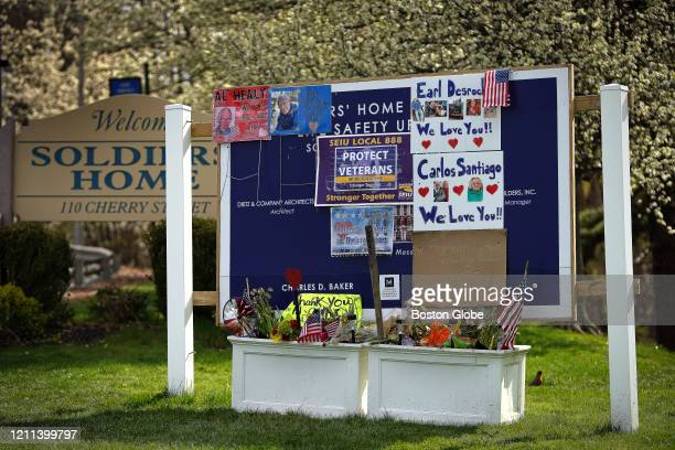Flags, wreaths, words of remembrance and thanks to nursing staff are seen on the grounds of the Holyoke Soldiers Home in Holyoke, MA on April 28...