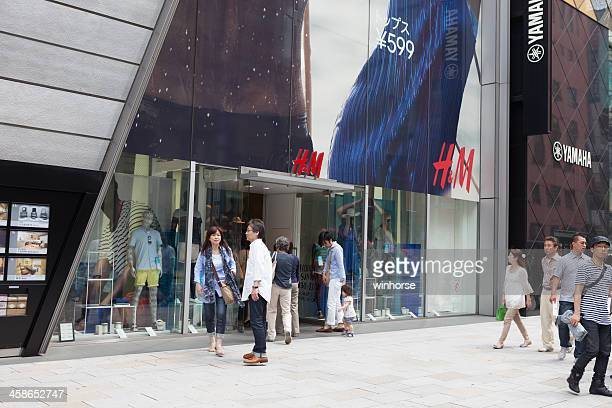 h&m flagship store in ginza, tokyo, japan - chuo dori street stock photos and pictures