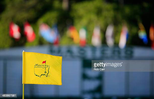 A flagstick and leaderboard are seen during the first round of the 2014 Masters Tournament at Augusta National Golf Club on April 10 2014 in Augusta...