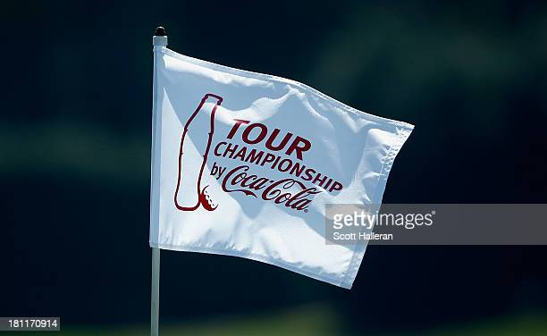 A flagstick is seen in the practice area during the first round of the TOUR Championship by CocaCola at East Lake Golf Club on September 19 2013 in...