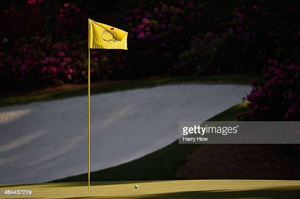 A flagstick is seen on the 13th green during the third round of the 2014 Masters Tournament at Augusta National Golf Club on April 12 2014 in Augusta...