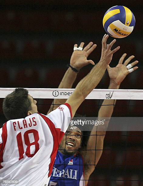 Flajs Andrej of Slovenia hits the ball as Vadeleux Romain of France blocks during their 2007 Men's European Championships qualification match in...