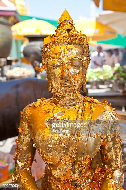 flaking golden figures, grand palace, bangkok, thailand - jake warga stock photos and pictures