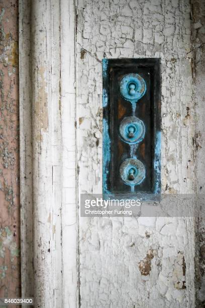 Flaking paint and an eroded light switch inside of Hopwood Hall which US film actor Hopwood DePree XIV hopes to restore to its former glory on...
