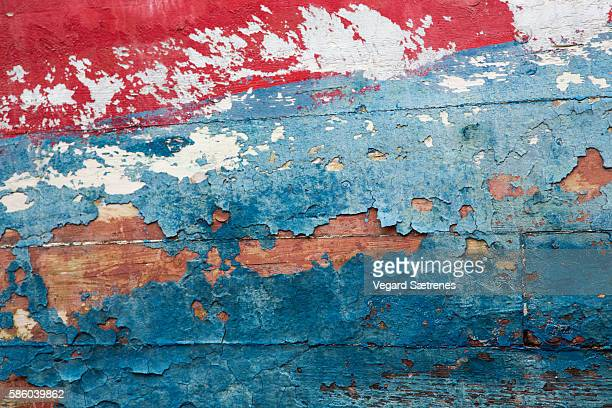 Flaking paint on wooden boat hull