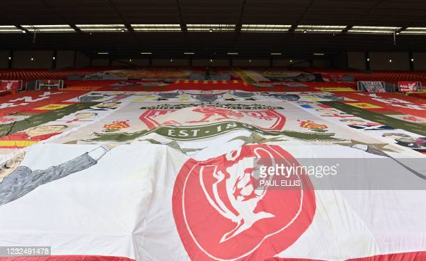Flalgs and banners are pictured over the empty supporters' seats, due to Covid-19 restrictions, in the Kop ahead of the English Premier League...