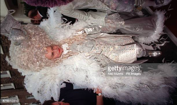 Flambouyant pop star Elton John leaving his London home in fancy dress on the way to his belated 50th birthday party 11/4/01 Sir Elton lost his...